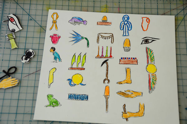 Egyptian cake pop-up card sketches of protective amulets and hieroglyphics for wrapping colored