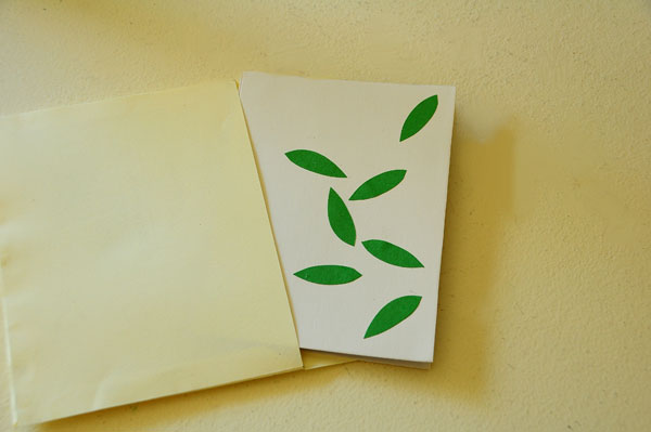 Tree pop-up card emerging from envelope